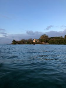 Sailing towards Chole. The building, known as the Boma is the location of the yoga sessions.